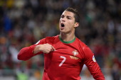Portugal's forward Cristiano Ronaldo celebrates after scoring the second goal for Portugal during the FIFA 2014 World Cup playoff football match...
