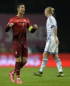 Portugal's forward Cristiano Ronaldo celebrates at the end of the Euro 2016 qualifying football match Portugal vs Denmark at the Municipal stadium in...