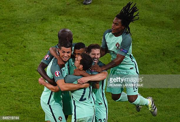 TOPSHOT Portugal's forward Cristiano Ronaldo celebrates scoring the opening goal with team mates during the Euro 2016 semifinal football match...