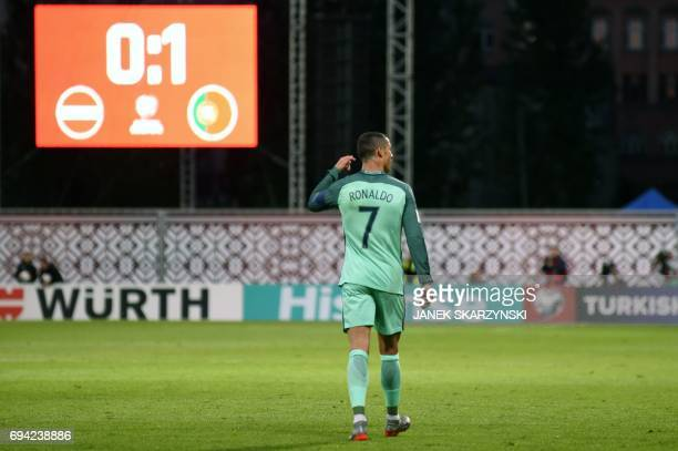 Portugal's forward Cristiano Ronaldo celebrates scoring the opening goal during the FIFA World Cup 2018 qualification football match between Latvia...