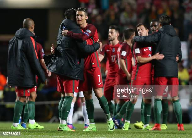 Portugal's forward Cristiano Ronaldo celebrates the victory with teammate Portugal's forward Andre Silva at the end of the FIFA 2018 World Cup...