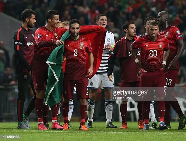 Portugal's forward Cristiano Ronaldo celebrates with goal scorer Portugal's midfielder Joao Moutinho the victory during the UEFA EURO 2016 Qualifier...