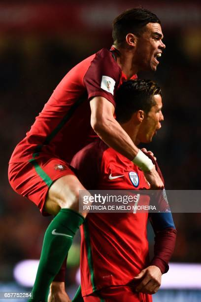 Portugal's forward Cristiano Ronaldo celebrates with his teammate Portugal's defender Pepe after scoring during the WC 2018 group B football...