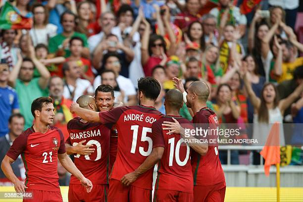 Portugal's forward Cristiano Ronaldo celebrates with his teammates after scoring against Estonia during the friendly football match Portugal vs...