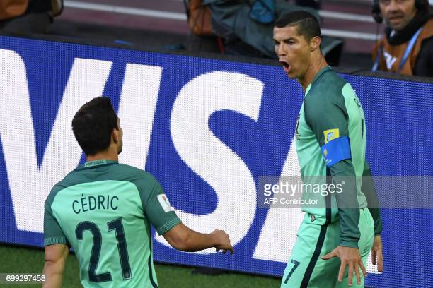 Portugal's forward Cristiano Ronaldo celebrates with Portugal's defender Cedric after scoring a goal during the 2017 Confederations Cup group A...