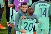 Portugal's forward Cristiano Ronaldo celebrates with Portugal's forward Ricardo Quaresma at the end of the Euro 2016 round of sixteen football match...