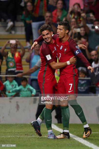 Portugal's forward Cristiano Ronaldo celebrates with Portugal's forward Andre Silva after scoring a goal during the 2018 FIFA World Cup qualifying...