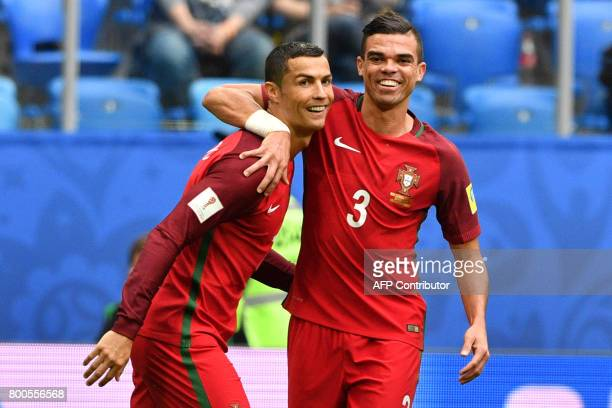 TOPSHOT Portugal's forward Cristiano Ronaldo celebrates with Portugal's defender Pepe after scoring a penalty during the 2017 Confederations Cup...