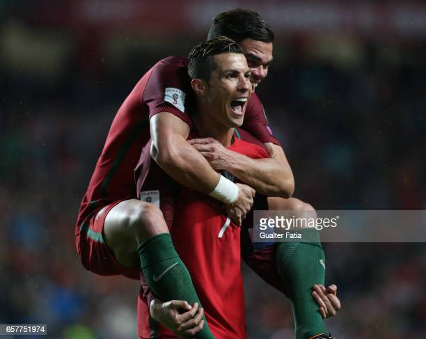 Portugal's forward Cristiano Ronaldo celebrates with teammate Portugal's defender Pepe after scoring a goalduring the FIFA 2018 World Cup Qualifier...