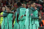Portugal's forward Cristiano Ronaldo celebrates with teammates after winning the round of sixteen football match Croatia against Portugal of the Euro...
