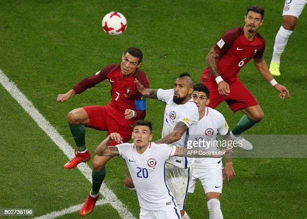 Portugal's forward Cristiano Ronaldo Chile's midfielder Charles Aranguiz midfielder Arturo Vidal and Chile's midfielder Pablo Hernandez fight for the...