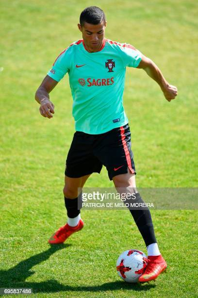 Portugal's forward Cristiano Ronaldo controls the ball during a training session at 'Cidade do Futebol' training camp in Oeiras outskirts of Lisbon...