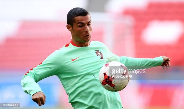 Portugal's forward Cristiano Ronaldo controls the ball during a training session at the Kazan Arena stadium in Kazan Russia on June 17 2017 on the...