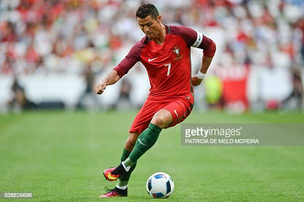 Portugal's forward Cristiano Ronaldo controls the ball during the friendly football match Portugal vs Estonia at Luz stadium in Lisbon on June 8 in...
