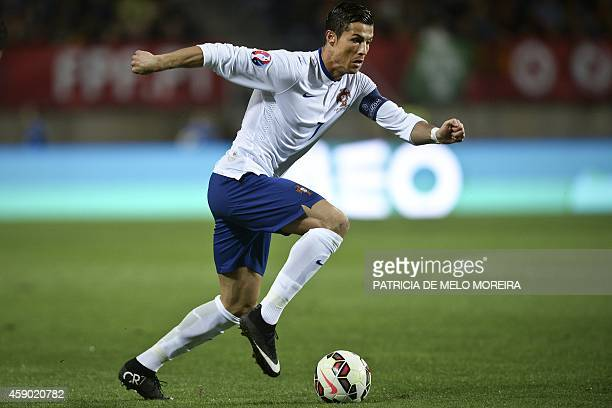 Portugal's forward Cristiano Ronaldo controls the ball during the UEFA EURO 2016 Qualifier Group I football match Portugal vs Armenia at the Algarve...