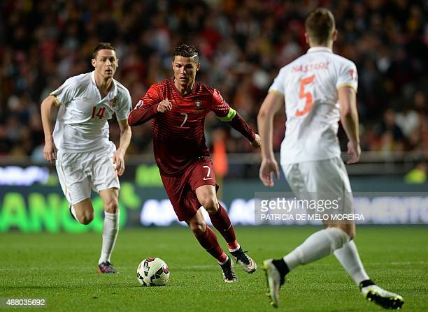 Portugal's forward Cristiano Ronaldo controls the ball during the Portugal vs Serbia EURO 2016 qualifying football match at Luz stadium in Lisbon on...