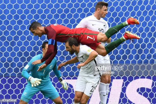 TOPSHOT Portugal's forward Cristiano Ronaldo falls over New Zealand's defender Andrew Durante after missing a goal during the 2017 Confederations Cup...