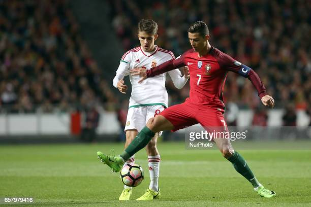 Portugal's forward Cristiano Ronaldo fights for the ball with Hungary's midfielder Adam Nagy during the FIFA World Cup Russia 2018 qualifier match...