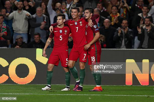Portugal's forward Cristiano Ronaldo from Portugal celebrates scores Portugal's third goal with Portugal's defender Raphael Guerreiro from Portugal...