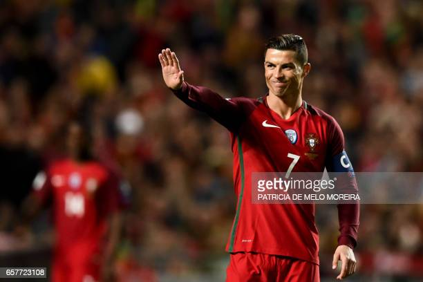 Portugal's forward Cristiano Ronaldo gestures after missing a goal opportunity during the WC 2018 group B football qualifing match Portugal vs...