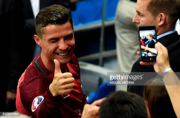 TOPSHOT Portugal's forward Cristiano Ronaldo gives a thumbs up after the Euro 2016 final football match between Portugal and France at the Stade de...