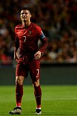 Portugal's forward Cristiano Ronaldo grimaces after a tackle during the Portugal vs Serbia EURO 2016 qualifying football match at Luz stadium in...