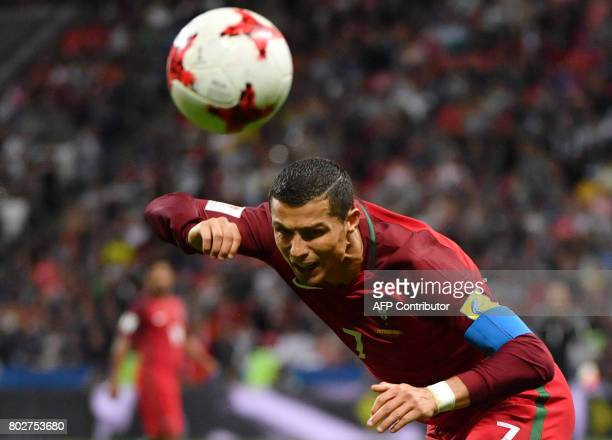 TOPSHOT Portugal's forward Cristiano Ronaldo heads the ball during the 2017 Confederations Cup semifinal football match between Portugal and Chile at...