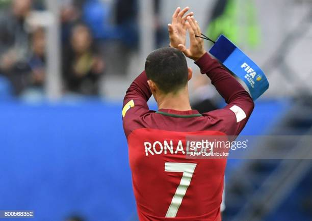 Portugal's forward Cristiano Ronaldo holds his captain armband as he leaves the pitch after being substituted during the 2017 Confederations Cup...