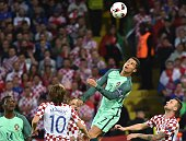 TOPSHOT Portugal's forward Cristiano Ronaldo jumps for the ball during the Euro 2016 round of sixteen football match Croatia vs Portugal on June 25...