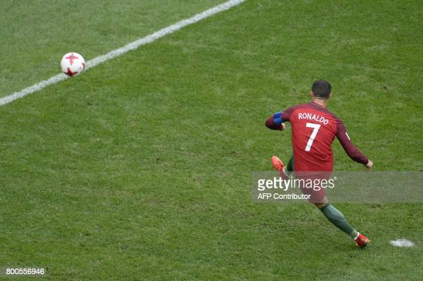Portugal's forward Cristiano Ronaldo kicks to score a penalty during the 2017 Confederations Cup group A football match between New Zealand and...