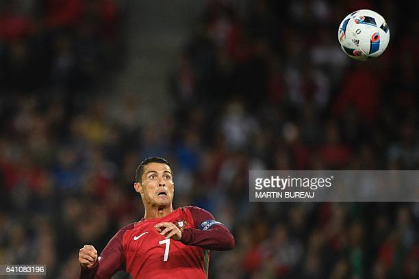 TOPSHOT Portugal's forward Cristiano Ronaldo plays the ball during the Euro 2016 group F football match between Portugal and Austria at the Parc des...