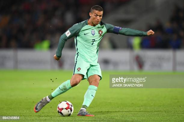 Portugal's forward Cristiano Ronaldo plays the ball during the FIFA World Cup 2018 qualification football match between Latvia and Portugal in Riga...