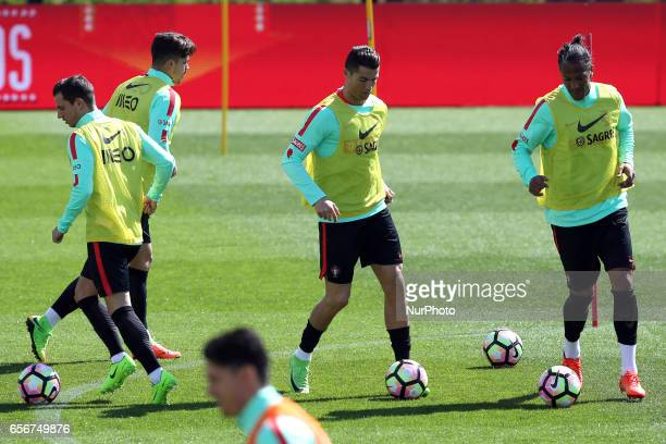 Portugals forward Cristiano Ronaldo Portugals defender Bruno Alves and Portugals defender Cedric in action during a training session at quotCidade do...