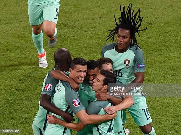 Portugal's forward Cristiano Ronaldo Portugal's midfielder Danilo Pereira Portugal's midfielder Renato Sanches and team mates celebrate after Ronaldo...