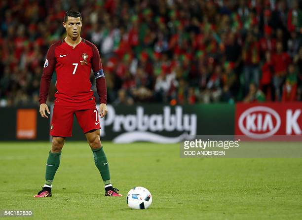 Portugal's forward Cristiano Ronaldo prepares for a free kick during the Euro 2016 group F football match between Portugal and Iceland at the...