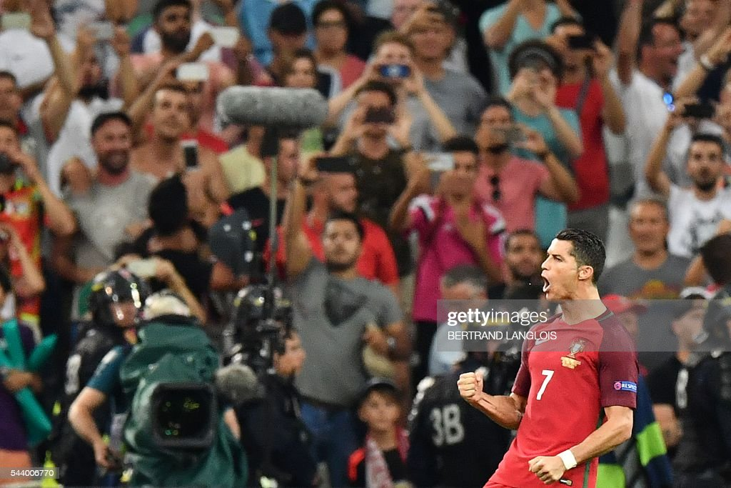 Portugal's forward Cristiano Ronaldo reacts after scoring the first in a penalty shoot-out during the Euro 2016 quarter-final football match between Poland and Portugal at the Stade Velodrome in Marseille on June 30, 2016. / AFP / BERTRAND