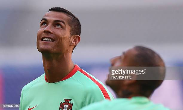 Portugal's forward Cristiano Ronaldo reacts during a training session at the Kazan Arena stadium in Kazan Russia on June 17 2017 on the eve of the...