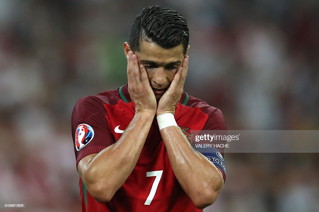 Portugal's forward Cristiano Ronaldo reacts during the Euro 2016 quarter-final football match between Poland and Portugal at the Stade Velodrome in Marseille on June 30, 2016. / AFP / Valery HACHE
