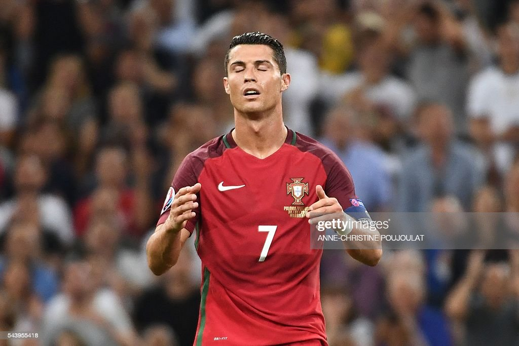 Portugal's forward Cristiano Ronaldo reacts during the Euro 2016 quarter-final football match between Poland and Portugal at the Stade Velodrome in Marseille on June 30, 2016. / AFP / ANNE