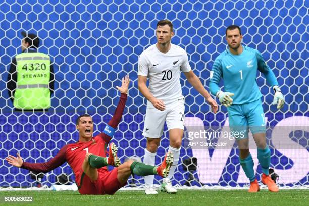 Portugal's forward Cristiano Ronaldo reacts next to New Zealand's defender Tommy Smith and New Zealand's goalkeeper Stefan Marinovic after missing a...