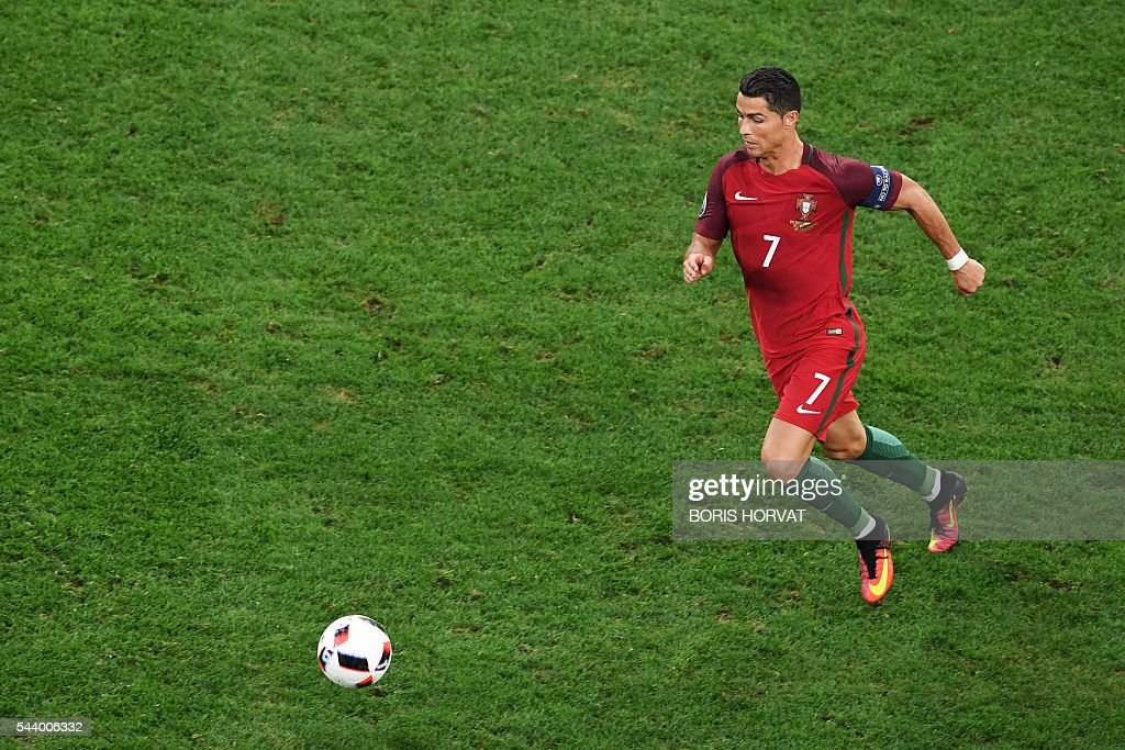Portugal's forward Cristiano Ronaldo runs for the ball during the Euro 2016 quarter-final football match between Poland and Portugal at the Stade Velodrome in Marseille on June 30, 2016. / AFP / BORIS