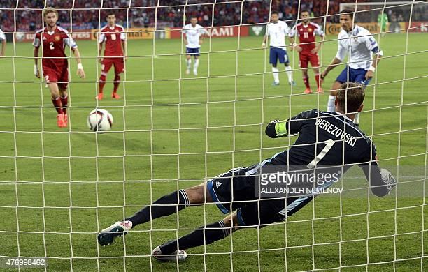 Portugal's forward Cristiano Ronaldo scores a goal from a penalty past Armenia's goalkeeper Roman Berezovski during the UEFA Euro 2016 qualifying...