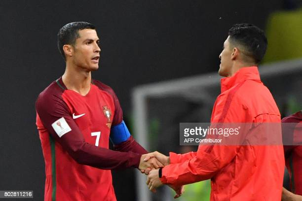 Portugal's forward Cristiano Ronaldo shakes hands with Chile's forward Alexis Sanchez after Chile won in the penalty shoot out during the 2017...