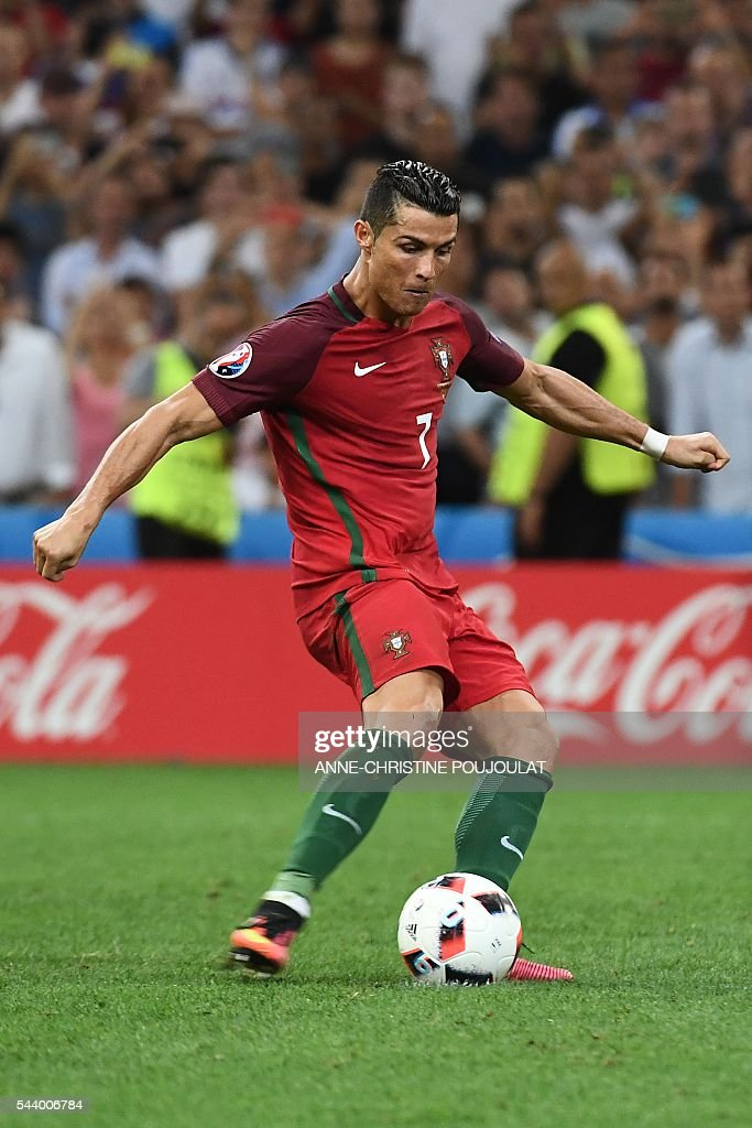Portugal's forward Cristiano Ronaldo shoots and scores the first in a penalty shoot-out during the Euro 2016 quarter-final football match between Poland and Portugal at the Stade Velodrome in Marseille on June 30, 2016. / AFP / ANNE