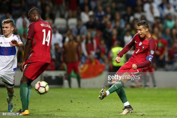 Portugal's forward Cristiano Ronaldo shoots to score during the 2018 FIFA World Cup qualifying football match between Portugal and Faroe Islands at...