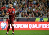 Portugal's forward Cristiano Ronaldo stands during the Portugal vs Serbia EURO 2016 qualifying football match at Luz stadium in Lisbon on March 29...