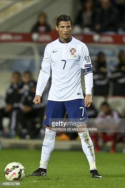 Portugal's forward Cristiano Ronaldo stands during the UEFA EURO 2016 Qualifier Group I football match Portugal vs Armenia at the Algarve Stadium in...