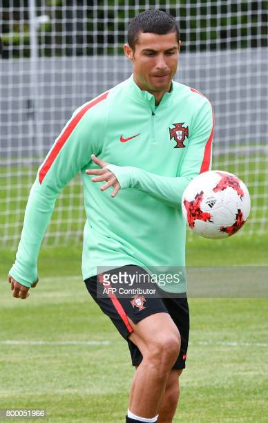 Portugal's forward Cristiano Ronaldo takes part in a training session in Saint Petersburg on June 23 2017 on the eve of the 2017 FIFA Confederations...