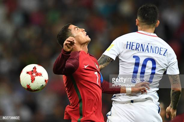 Portugal's forward Cristiano Ronaldo vies for the ball against Chile's midfielder Pablo Hernandez during the 2017 Confederations Cup semifinal...