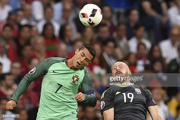 Portugal's forward Cristiano Ronaldo vies for the ball against Wales' defender James Collins during the Euro 2016 semifinal football match between...